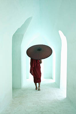 Buddhist Monk Walking Along Arched Temple Corridor Print by Martin Puddy