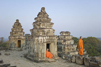 Buddhist Monks Amongst Temple Ruins Print by Martin Puddy