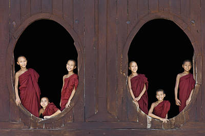 Buddhist Monks In Window Of Monastery Print by Martin Puddy
