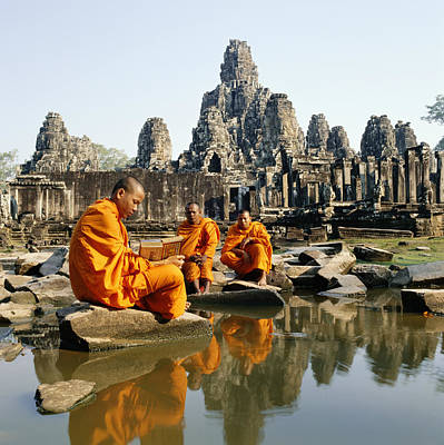 Buddhist Monks Sitting In Front Of Temple Reading Manuscripts Print by Martin Puddy