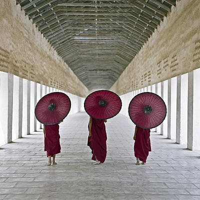 Buddhist Monks Walking Along Temple Corridor Print by Martin Puddy
