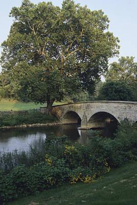 Burnside Bridge Photograph - Burnside Bridge Spans Antietam Creek by Raymond Gehman