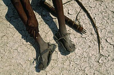 Bushman Photograph - Bushman Hunter Rests On The Ground by Chris Johns