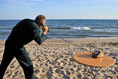 Businessman On Beach With Landline Phone Art Print by Sami Sarkis