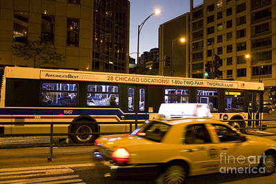 Cab And Bus Speeding On Michigan Avenue Art Print by Christopher Purcell