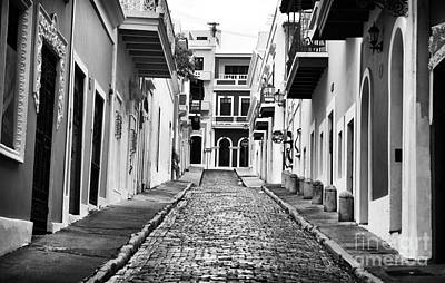 Calle De Guijarro Print by John Rizzuto
