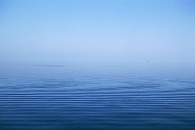 Calm Blue Water Disappearing Into Print by Axiom Photographic