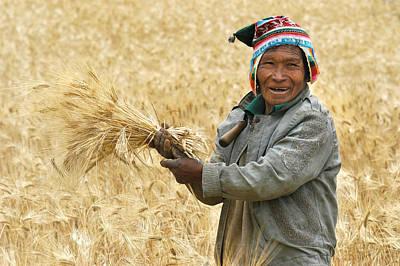 campesino cutting wheat. Republic of Bolivia. Art Print by Eric Bauer