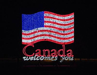 Photograph - Canada Welcomes You - Us Flag by Peggy King