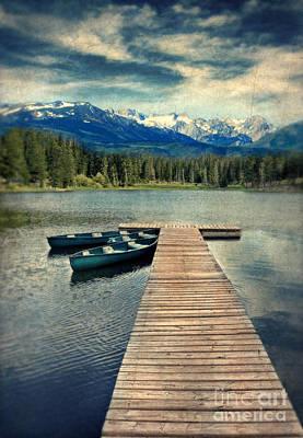 Canoes At Dock On Mountain Lake Art Print by Jill Battaglia