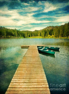 Canoes At The End Of The Dock Art Print by Jill Battaglia