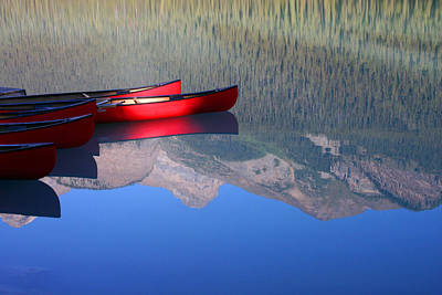 Canoes In The Rockies Art Print by Steve Parr