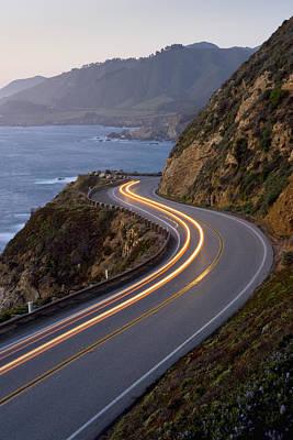 Car Headlights On California Highway 1 Art Print by Greg Probst