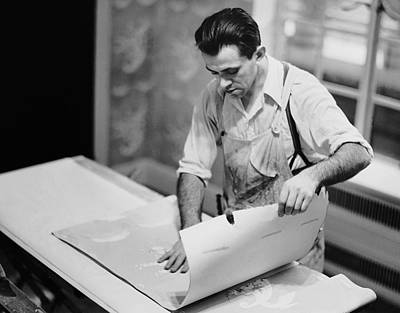 Carpenter Putting On Wallpaper Art Print by George Marks
