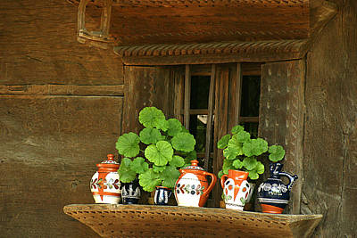 Photograph - Ceramic Jugs And Geraniums At The Window by Emanuel Tanjala