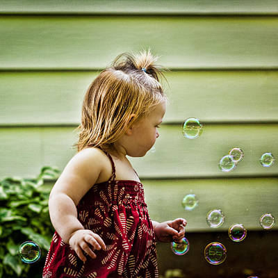Floating Girl Photograph - Chasing Bubbles by Matt Dobson