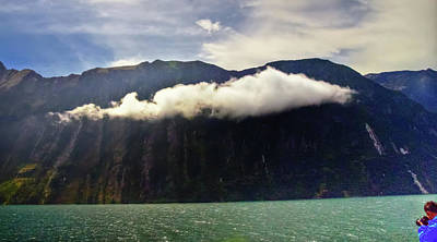 Photograph - Checking Out The Passing Clouds At Milford Sound by Harry Strharsky
