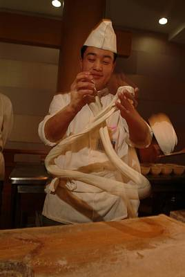 Chef Twirls Dough As He Makes Fresh Art Print by Richard Nowitz