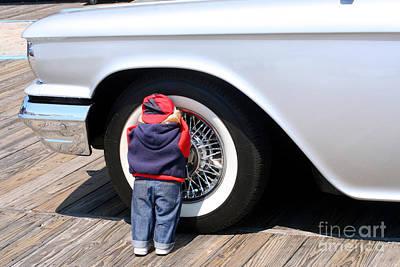 Photograph - Child Doll Hiding Against Antique Car by Susan Stevenson