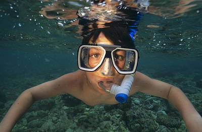 Snorkelling Photograph - Child Snorkelling by Alexis Rosenfeld