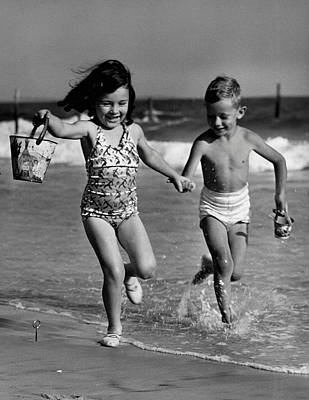 Children Playing At Seashore Art Print by George Marks