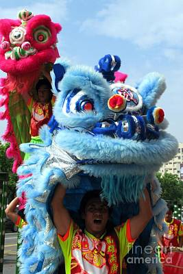 Good Luck Photograph - Chinese Lion Dancers In Taiwan's Southern City Of Kaohsiung by Yali Shi