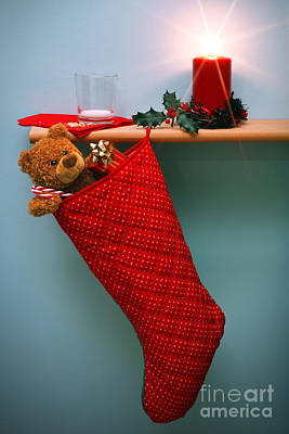 Christmas Stocking Filled With Presents With Empty Milk Glass.  Art Print by Richard Thomas