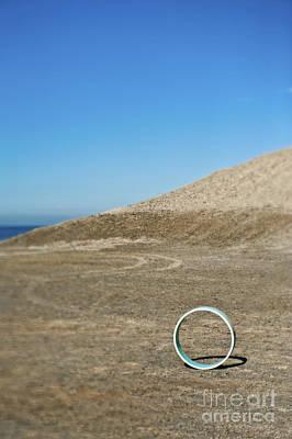 Circular Object On Beach Art Print by Eddy Joaquim