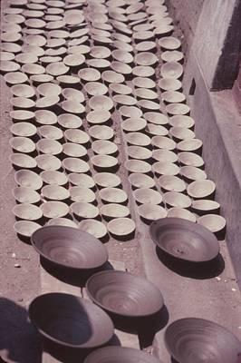 Hand Thrown Pottery Photograph - Clay Yogurt Cups Drying In The Sun by David Sherman