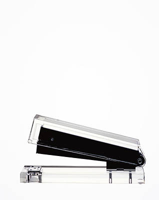 Y120831 Photograph - Clear Stapler On White With Copy Space by Peter Dazeley