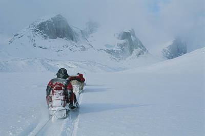 Baffin Island Photograph - Climbers Travel Over Baffin Island Via by Gordon Wiltsie