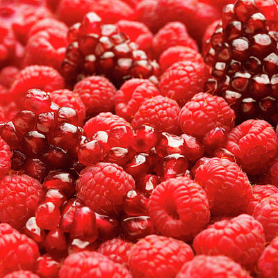 Food And Drink Photograph - Close Up Of Fresh Raspberries And Pomegranate by Andrew Bret Wallis