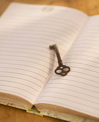 Y120907 Photograph - Close Up Of Open Notebook With Key, Studio Shot by Daniel Grill