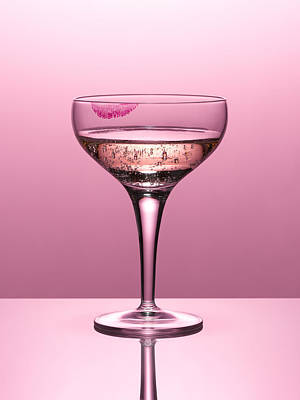 Photograph - Close Up Of Pink Champagne In Glass With Lipstick Stain by Andy Roberts