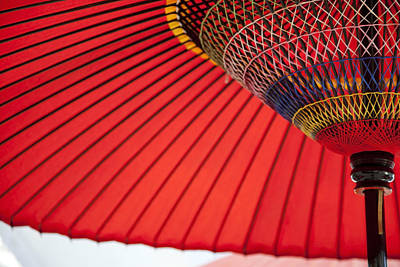On Paper Photograph - Close Up Of Red Parasol by Imagewerks