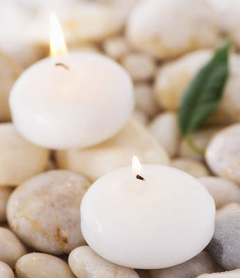 Y120907 Photograph - Close Up Of Tea Lights And Green Leaf On Pebble Stones, Studio Shot by Daniel Grill