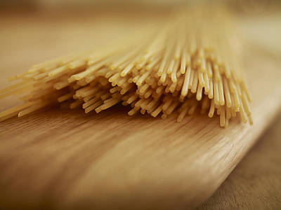 Close Up Of Uncooked Spaghetti Noodles On Cutting Board Art Print