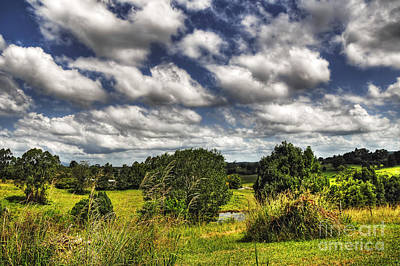 Clouds Floating Over Green Countryside Art Print by Kaye Menner