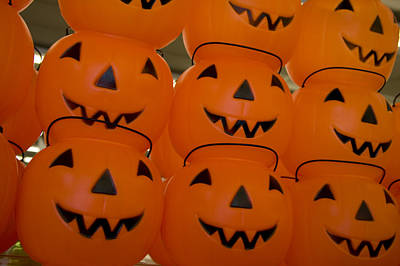 Toy Store Photograph - Colorful Plastic Jack-o-lanterns Grin by Stephen St. John