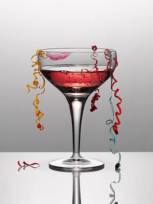 Photograph - Confetti Hanging From Glass Of Pink Champagne With Lipstick Stain by Andy Roberts
