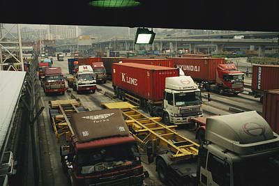 Importers And Importing Photograph - Containers Being Loaded At The Hong by Justin Guariglia