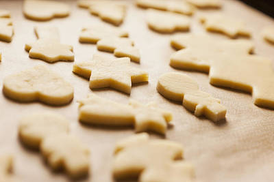 Photograph - Cookie Dough In Christmas Shapes by Cultura/Nils Hendrik Mueller