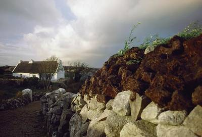 Connaught Photograph - Cottage With Turf Stack, Gorumna by The Irish Image Collection