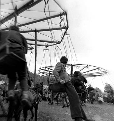 Photograph - Country Fair Swings by Emanuel Tanjala