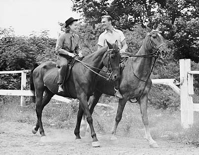 Couple Horseback Riding Art Print by George Marks