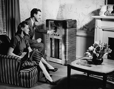 Couple Listening To Radio In Living Room, (b&w) Art Print by George Marks