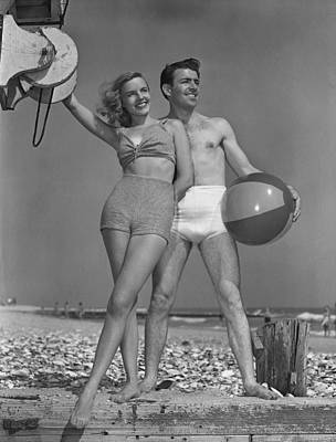 Couple On Beach W/beach Ball Art Print by George Marks