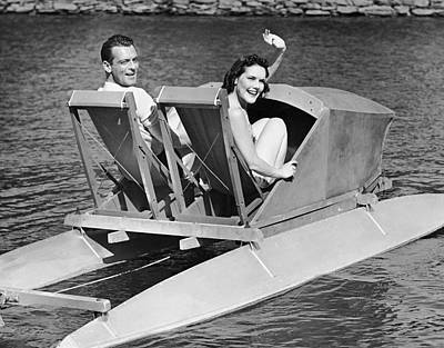 Couple On Lake In Paddle Boat Art Print by George Marks