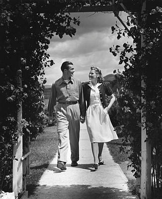 Couple Outdoors Holding Hands While Walking Art Print by George Marks