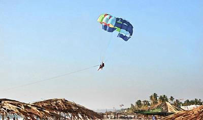 Couple Parasailing Over Shacks Goa Art Print by Kantilal Patel